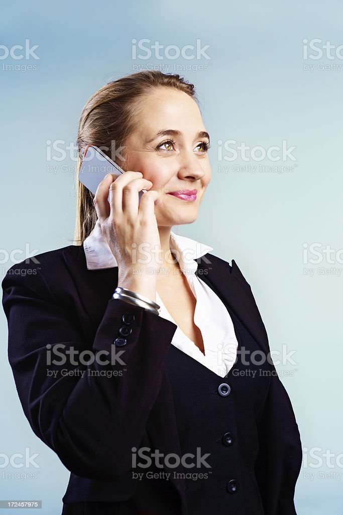 Confident, smiling young businesswoman talking on cellphone stock photo