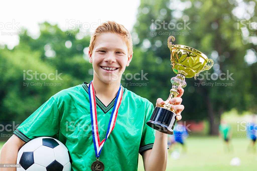 Confident soccer champ after win stock photo