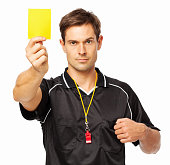 Confident Soccer Referee Showing Yellow Card