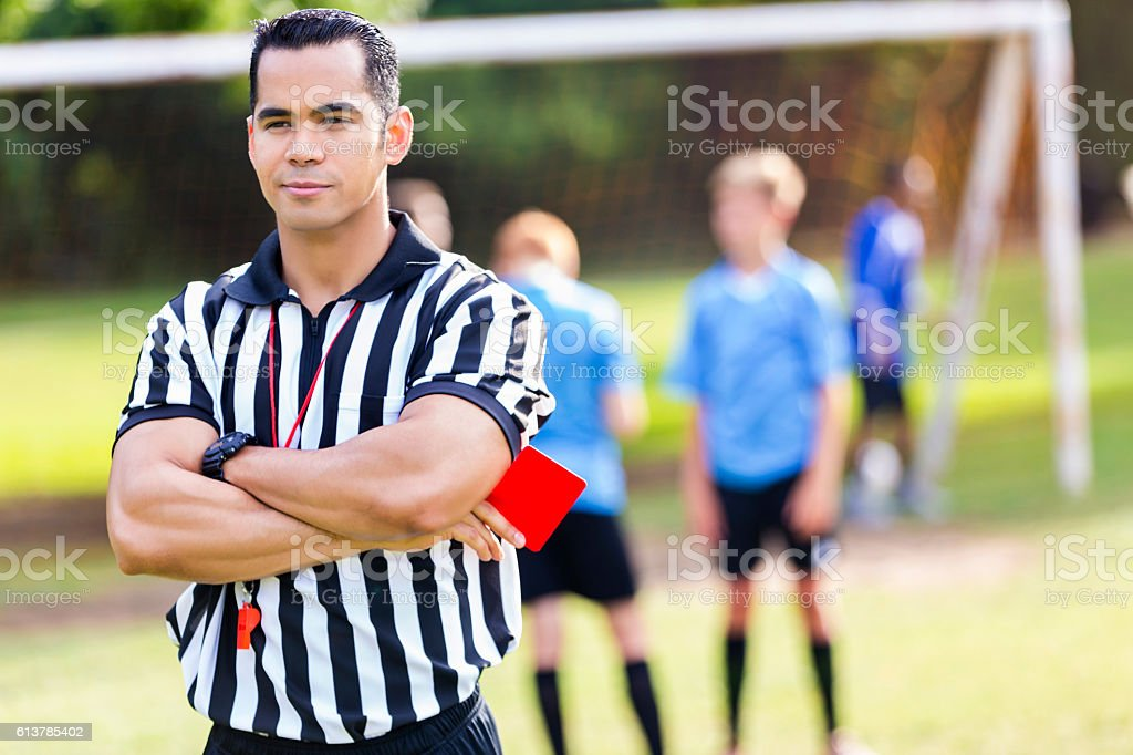 Confident soccer referee with red card stock photo