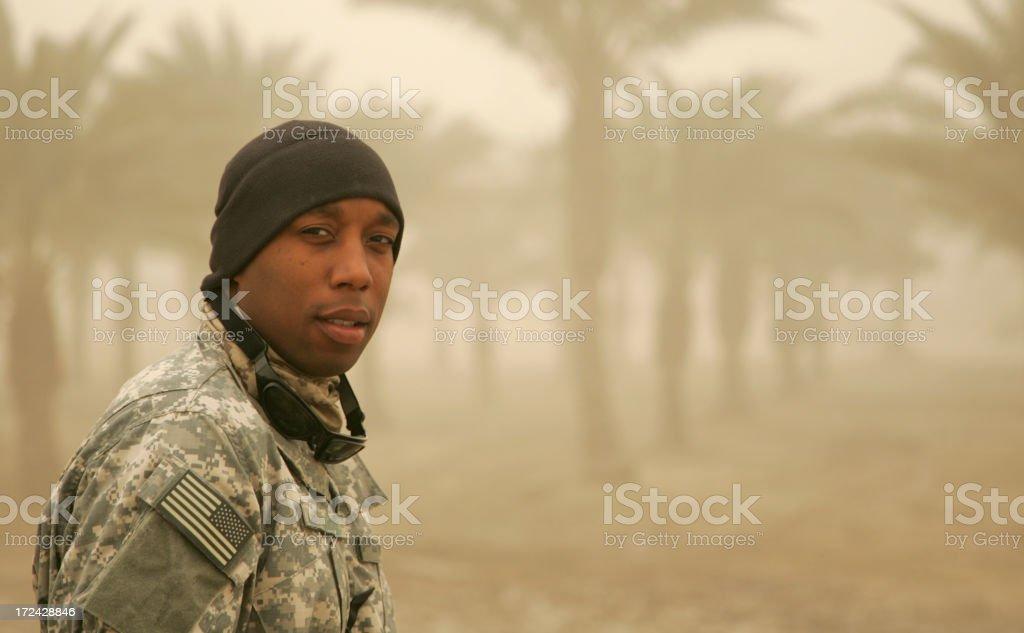 Confident Soldier in Sandstorm stock photo