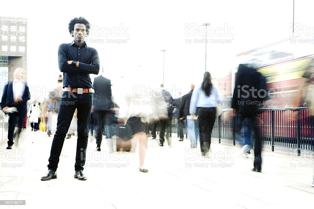 Confident stance from a solitary character in a fast-paced world royalty-free stock photo