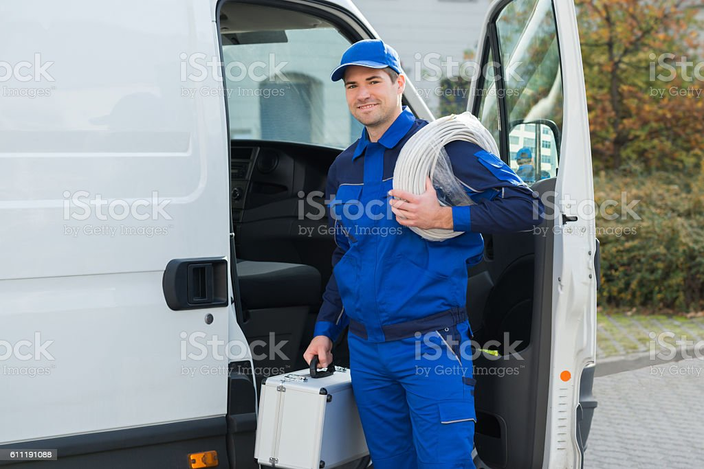 Confident Technician With Cable Coil And Toolbox stock photo