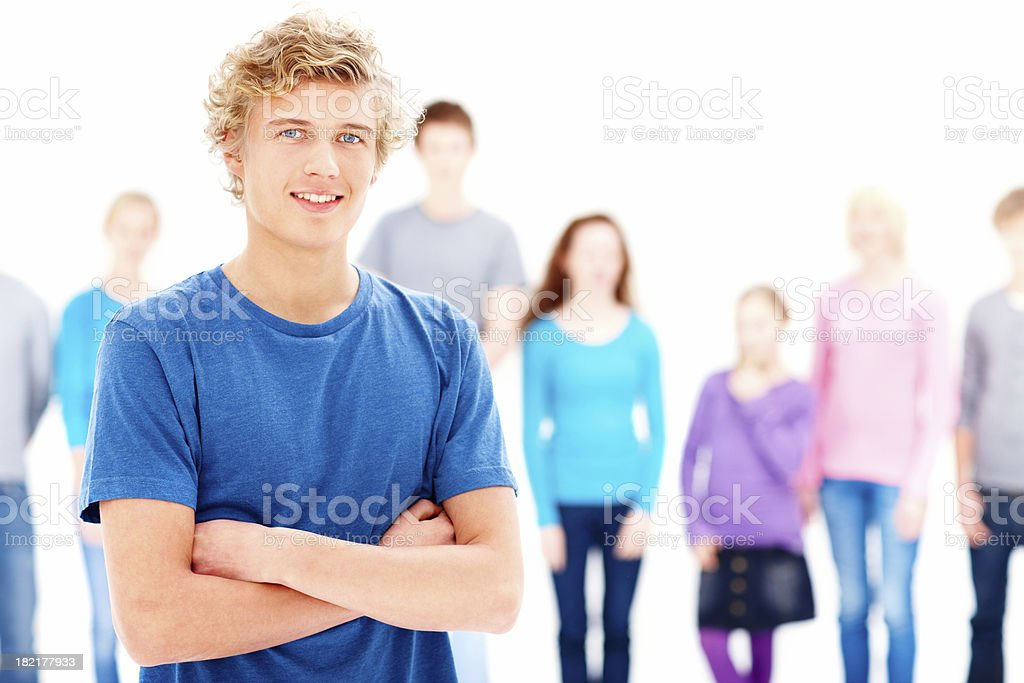 Confident teenage boy with arms crossed royalty-free stock photo