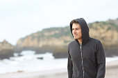 Confident teenager walking on the beach