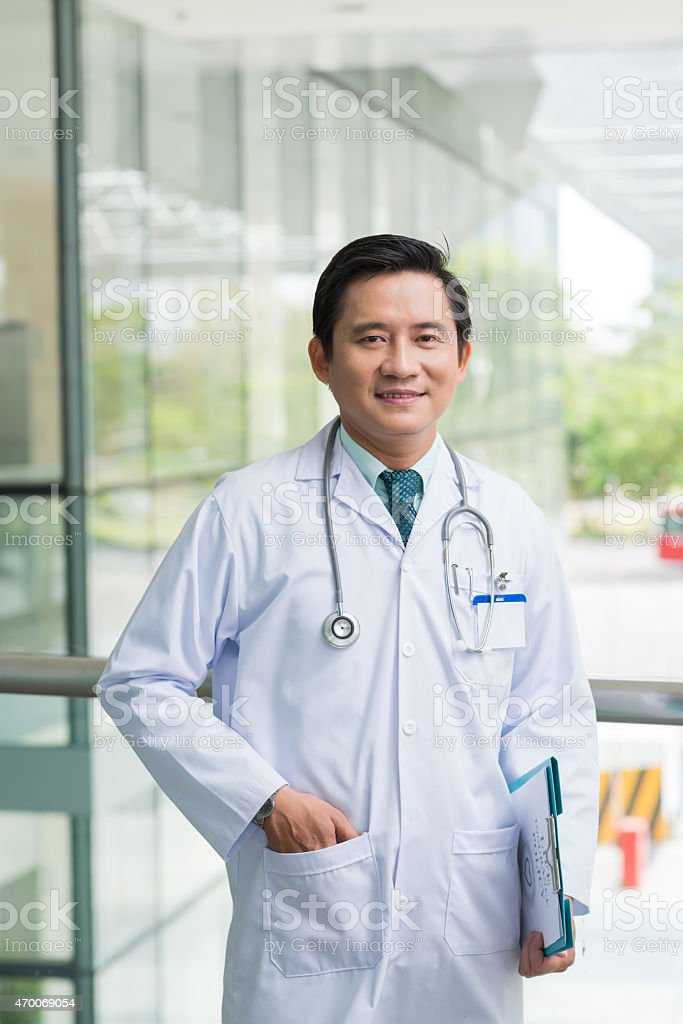 Confident Vietnamese doctor stock photo