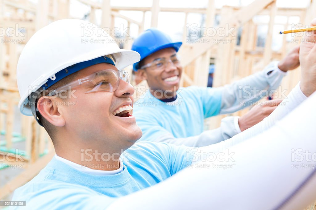 Confident volunteer works on charity house stock photo
