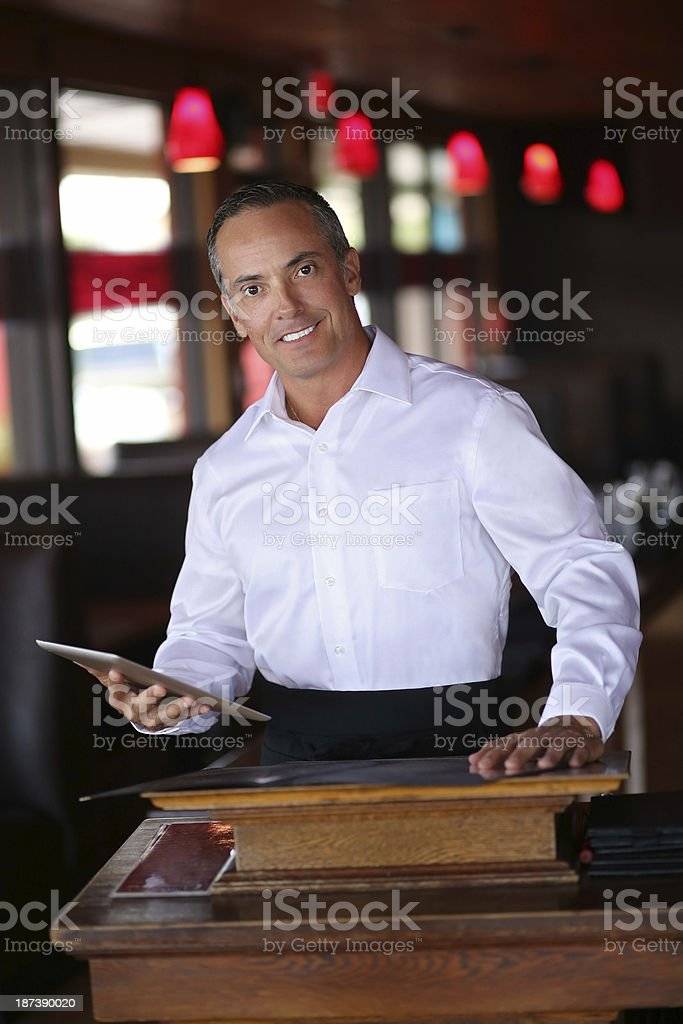 Confident Waiter Holding Digital Tablet In Restaurant royalty-free stock photo