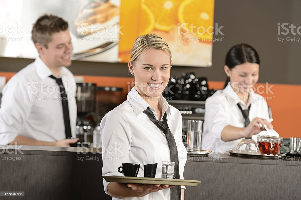 Confident waitress serving coffee with tray royalty-free stock photo