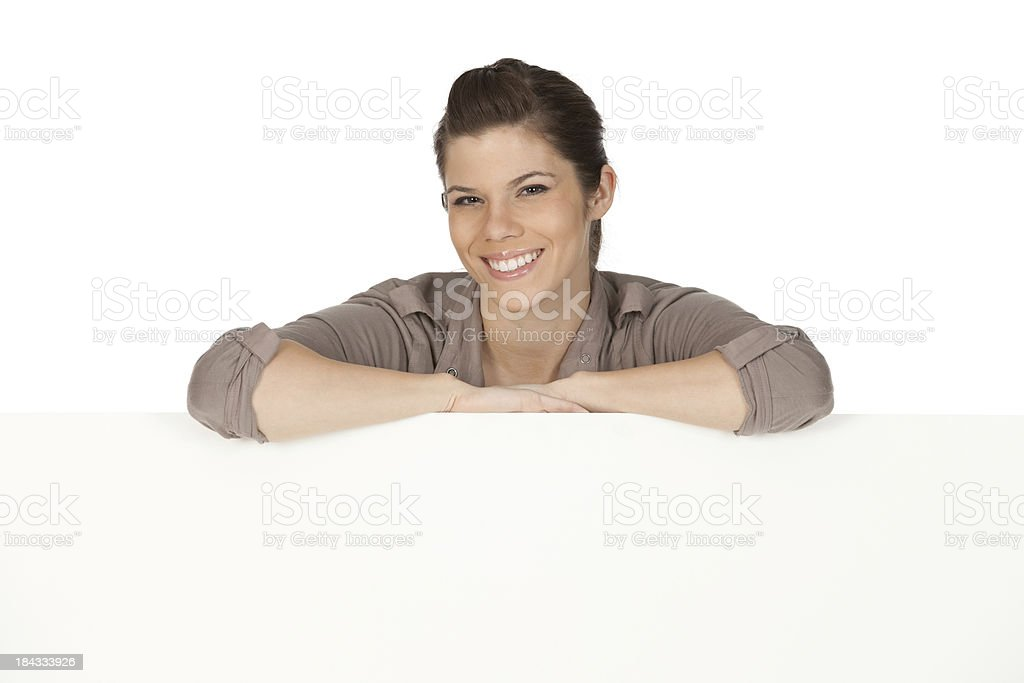 Confident woman behind a placard royalty-free stock photo