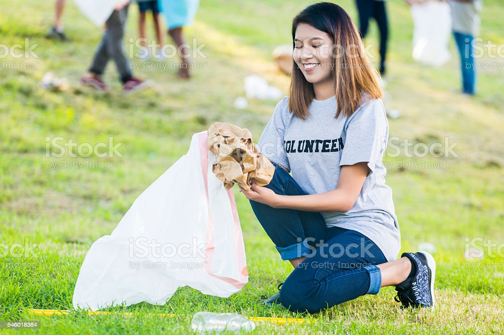 Confident woman helps with neighborhood beautification day stock photo