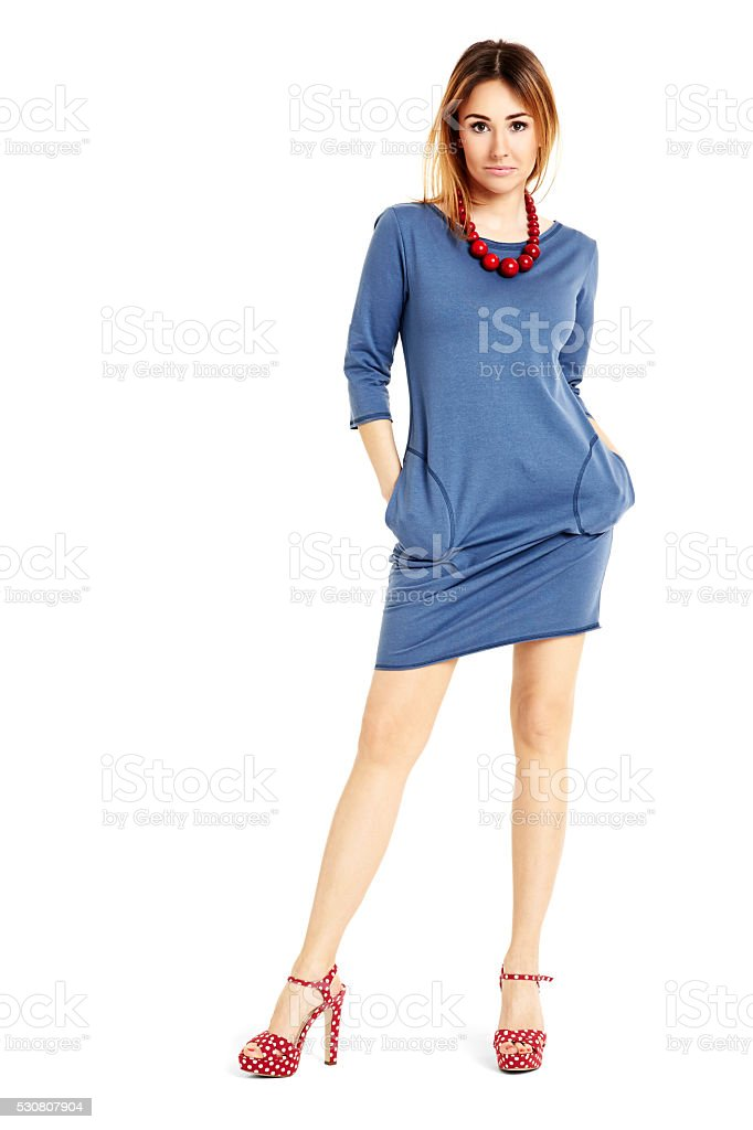 Confident woman in blue dress stock photo
