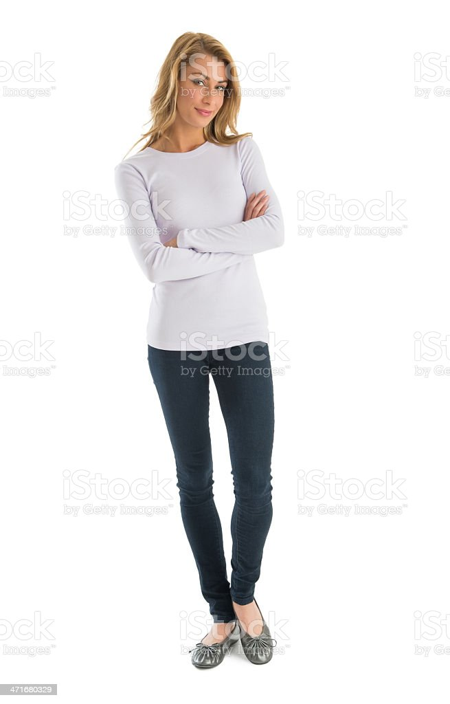 Confident Woman In Casuals Standing Arms Crossed stock photo