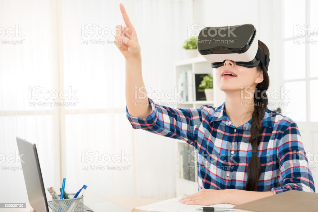 confident woman in virtual reality headset stock photo