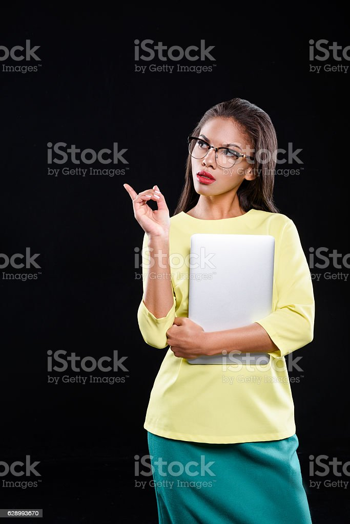 Confident woman is looking aside stock photo