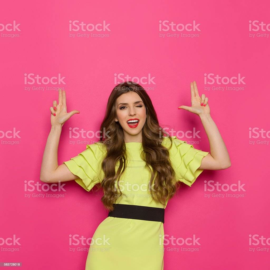 Confident Woman Posing With Two Hand Pistol stock photo