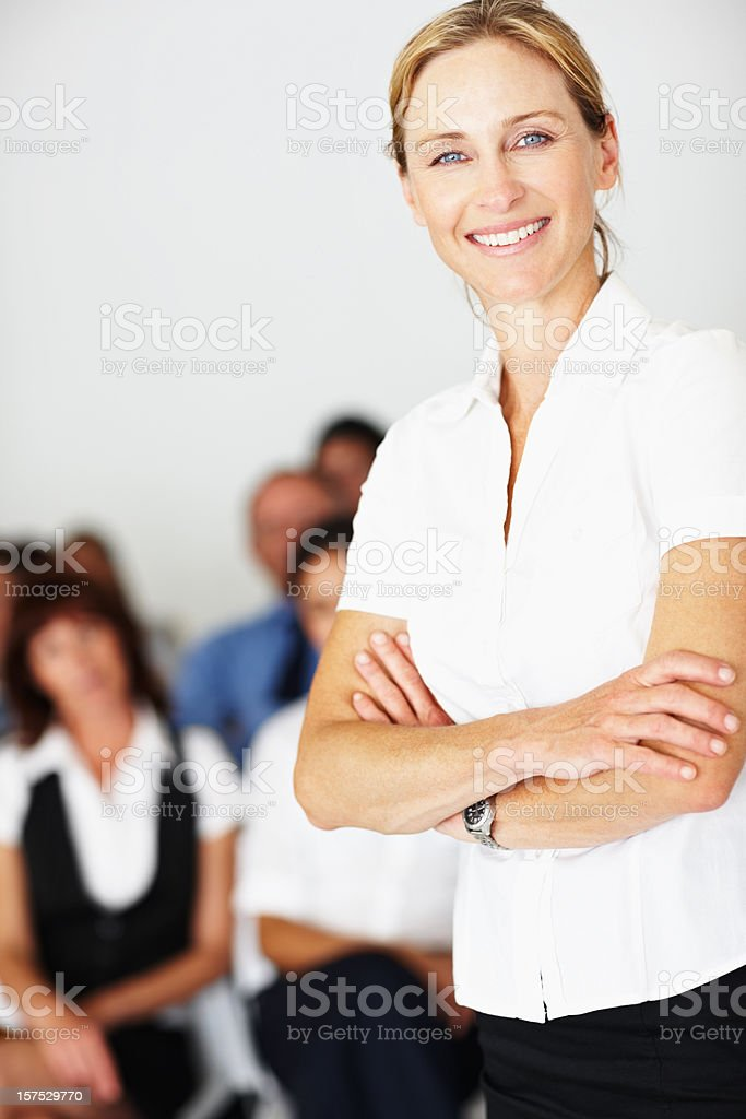 Confident woman with business colleagues in background royalty-free stock photo