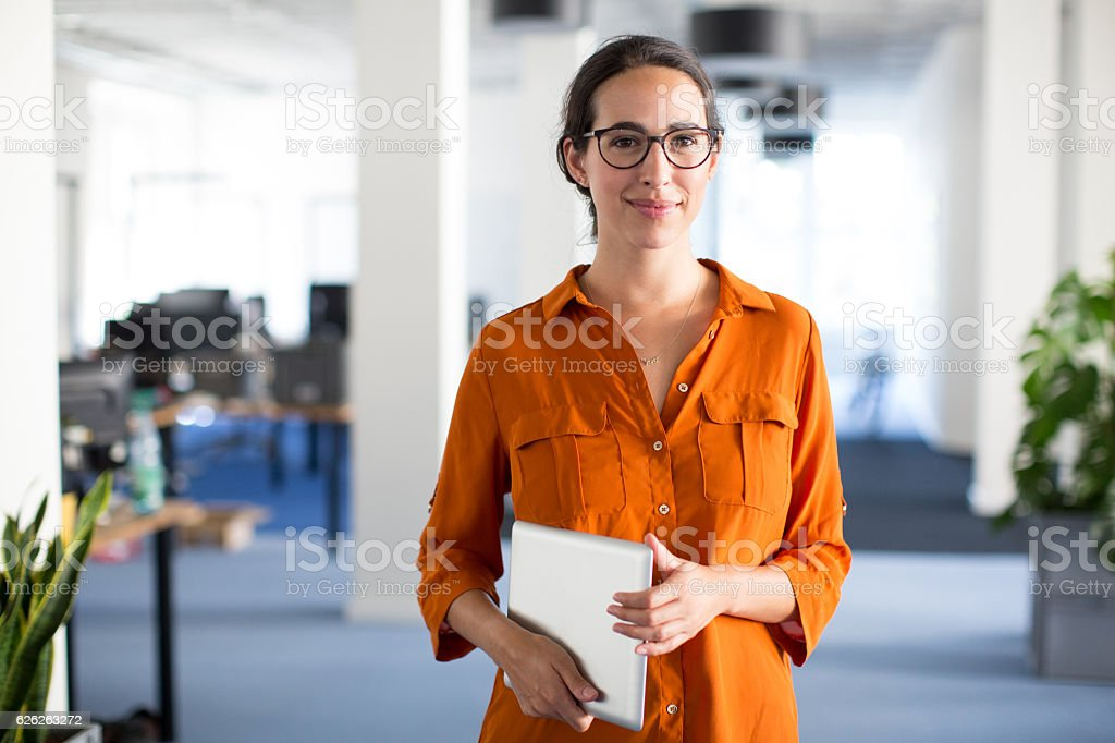 Confident woman with eyeglasses stock photo