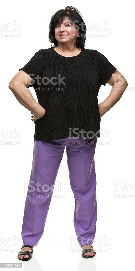 Confident Woman With Hands on Hips stock photo
