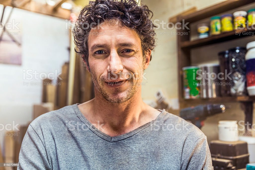 Confident worker smiling in workshop stock photo