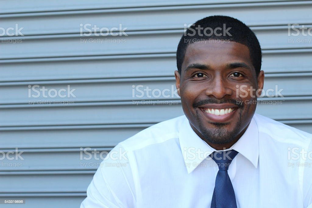Confident young African businessman smiling happy stock photo