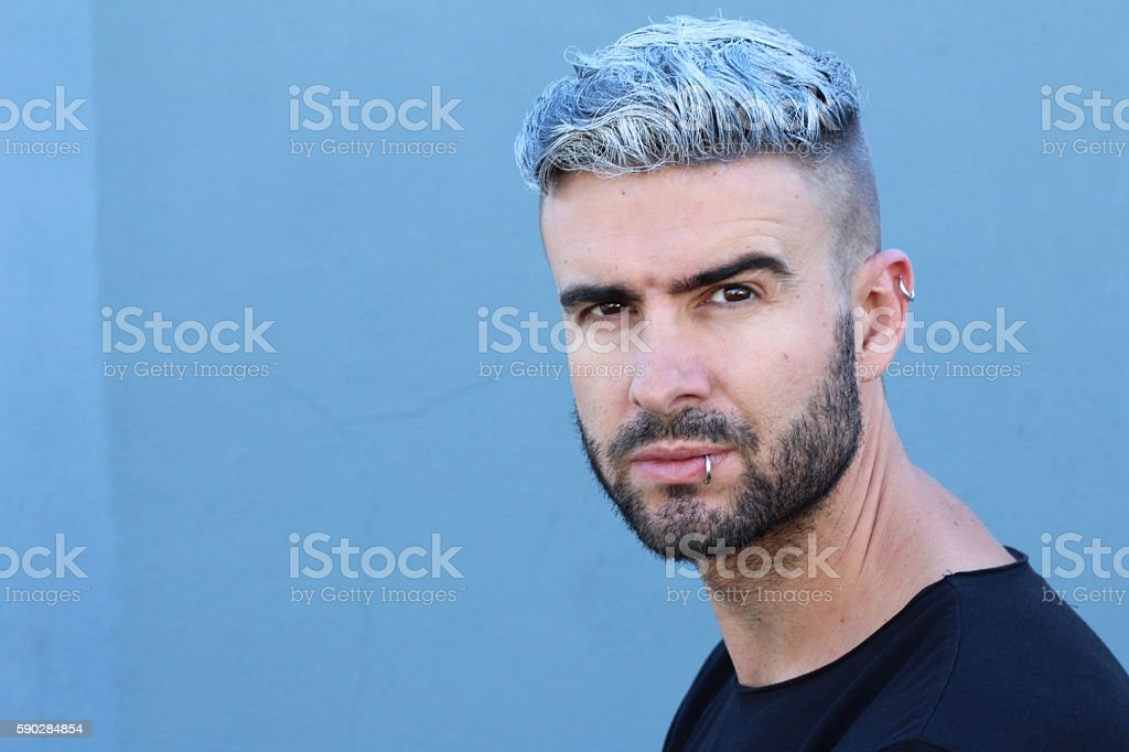 Confident young alternative bearded handsome man stock photo