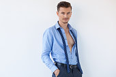 Confident Young Business Man in Unbuttoned Shirt