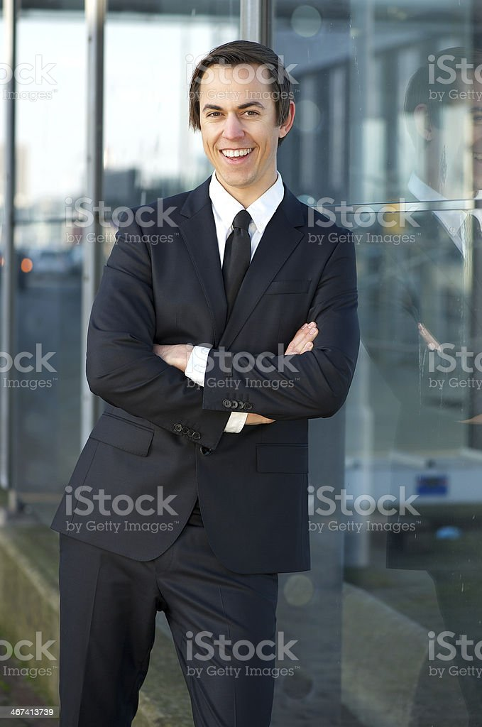 Confident young business man smiling outdoors royalty-free stock photo