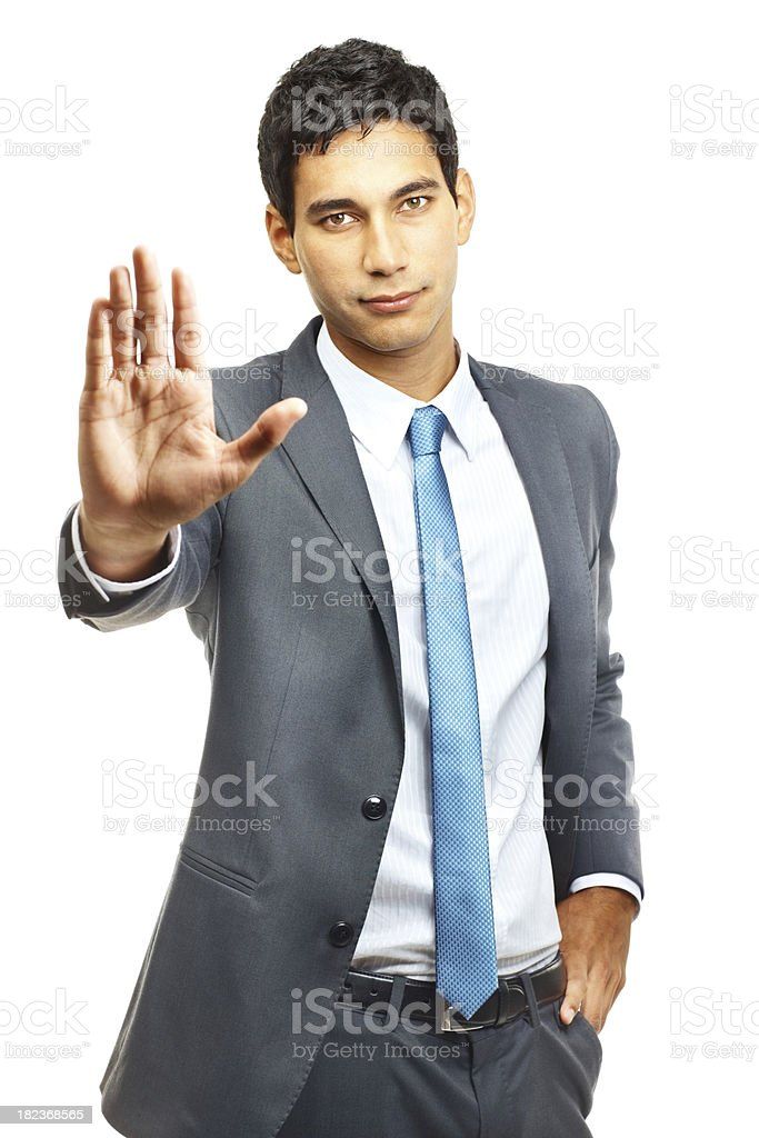 Confident young businessman asking you to stop royalty-free stock photo