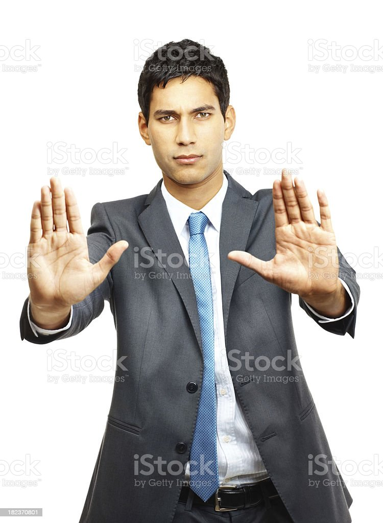 Confident young businessman gesturing stop sign royalty-free stock photo