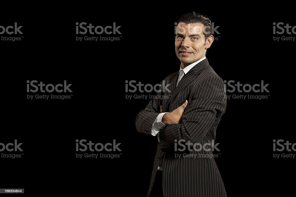 Confident young businessman on black background royalty-free stock photo