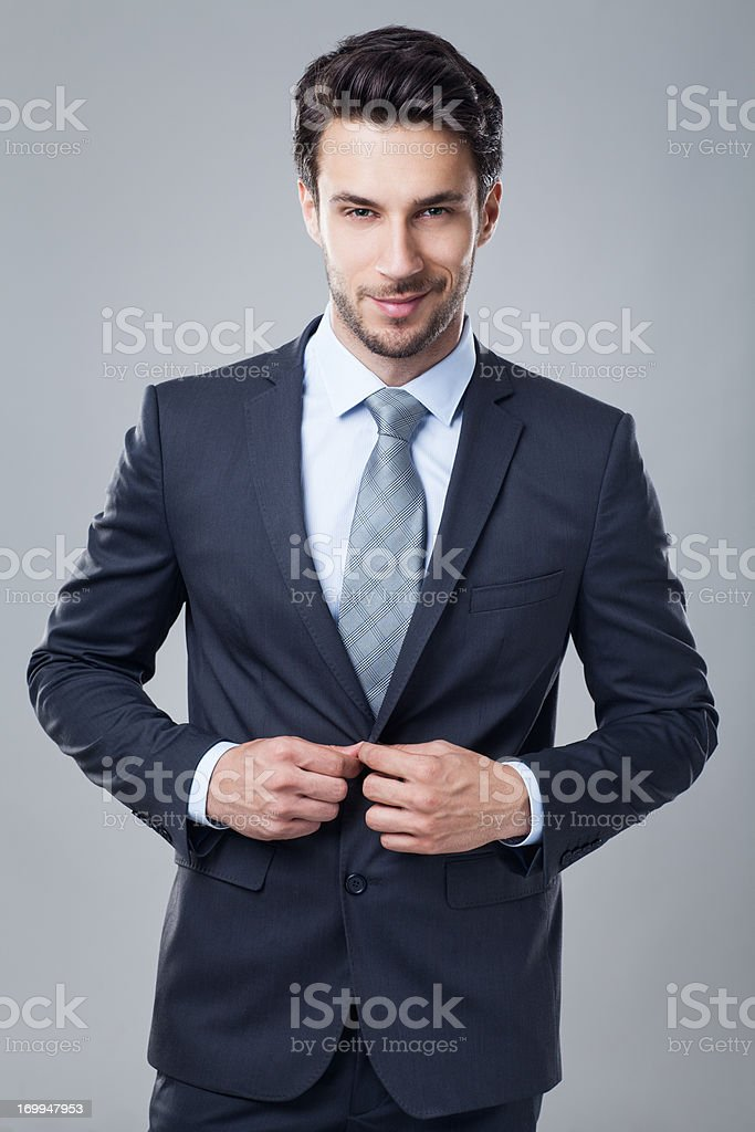Confident young businessman stock photo