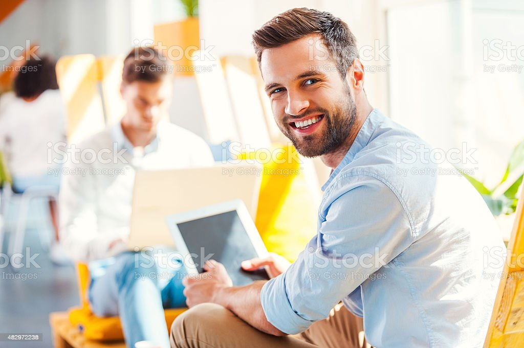 Confident young businessman. stock photo