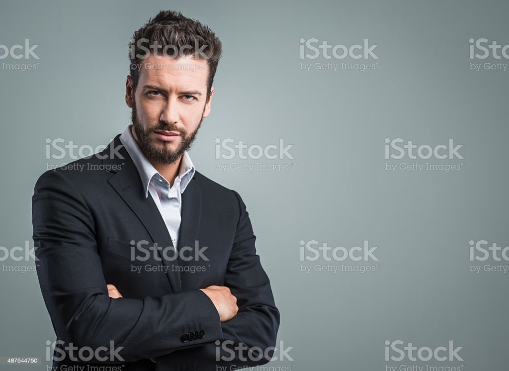 Confident young businessman posing stock photo