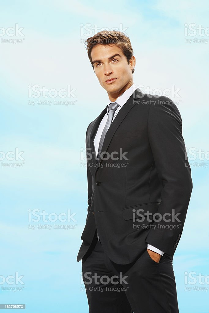 Confident young businessman standing with hands in pocket royalty-free stock photo