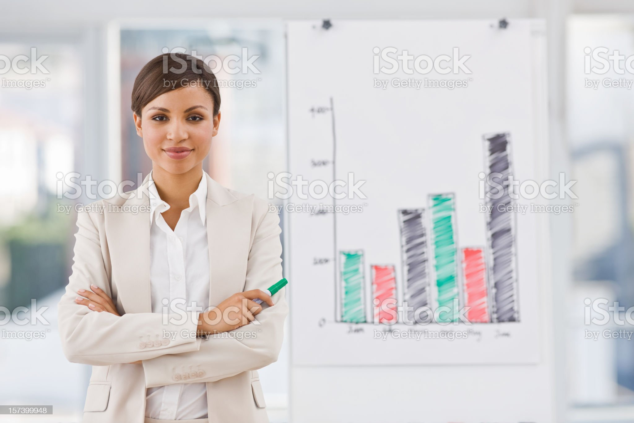 Confident young businesswoman standing by whiteboard royalty-free stock photo