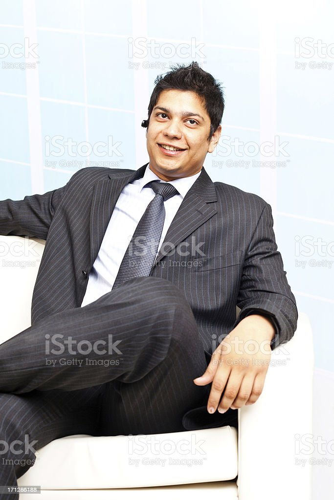 Confident young cheerful Indian Business Person People sitting on Sofa royalty-free stock photo