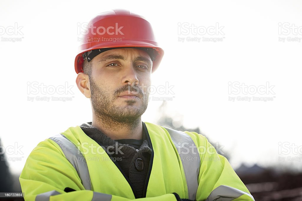 Confident young construction worker looking at camera stock photo