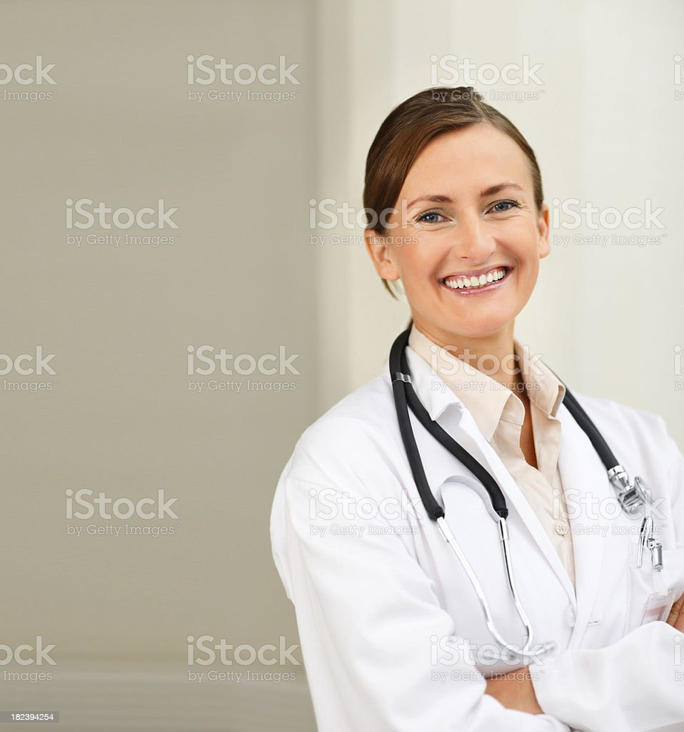 Confident young doctor smiling royalty-free stock photo