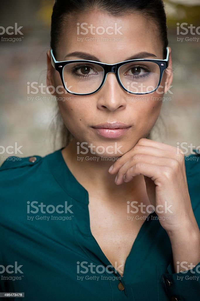 Confident young female office worker wearing eyeglasses stock photo