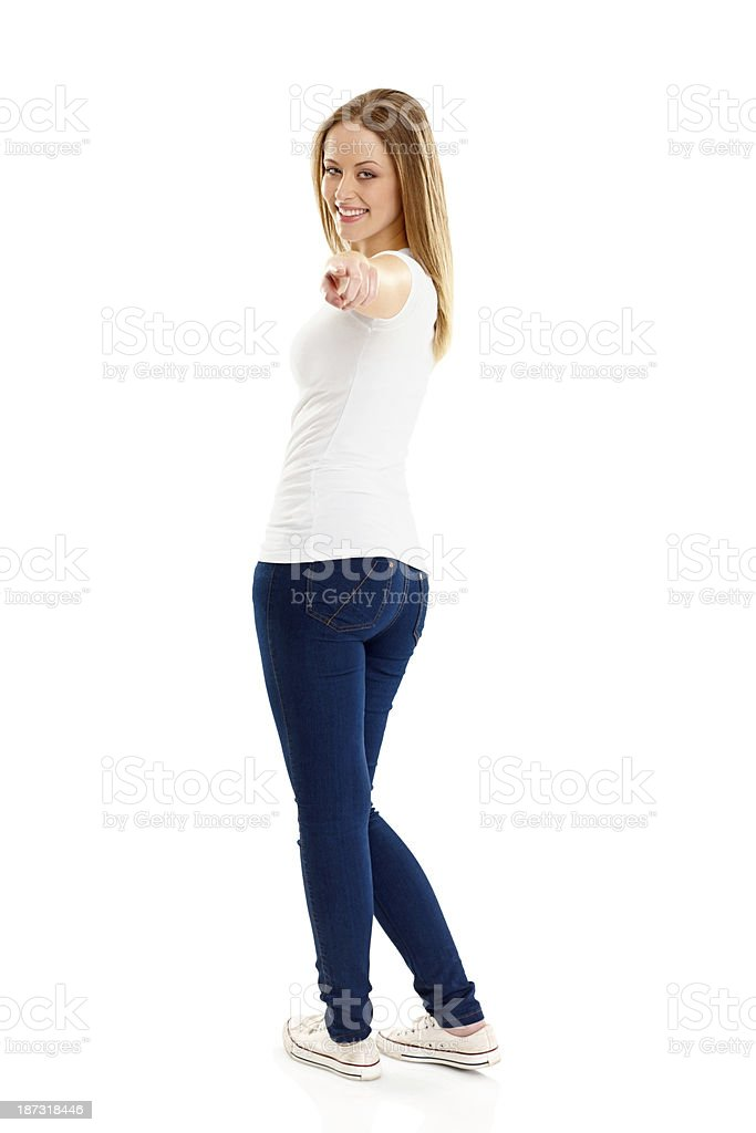 Confident young girl pointing at you royalty-free stock photo