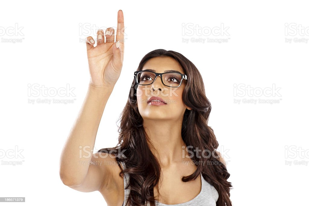 Confident young lady touching virtual screen royalty-free stock photo