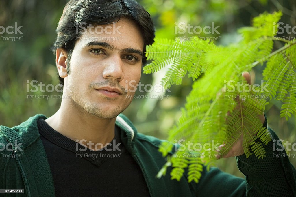 Confident young man in natural environment royalty-free stock photo