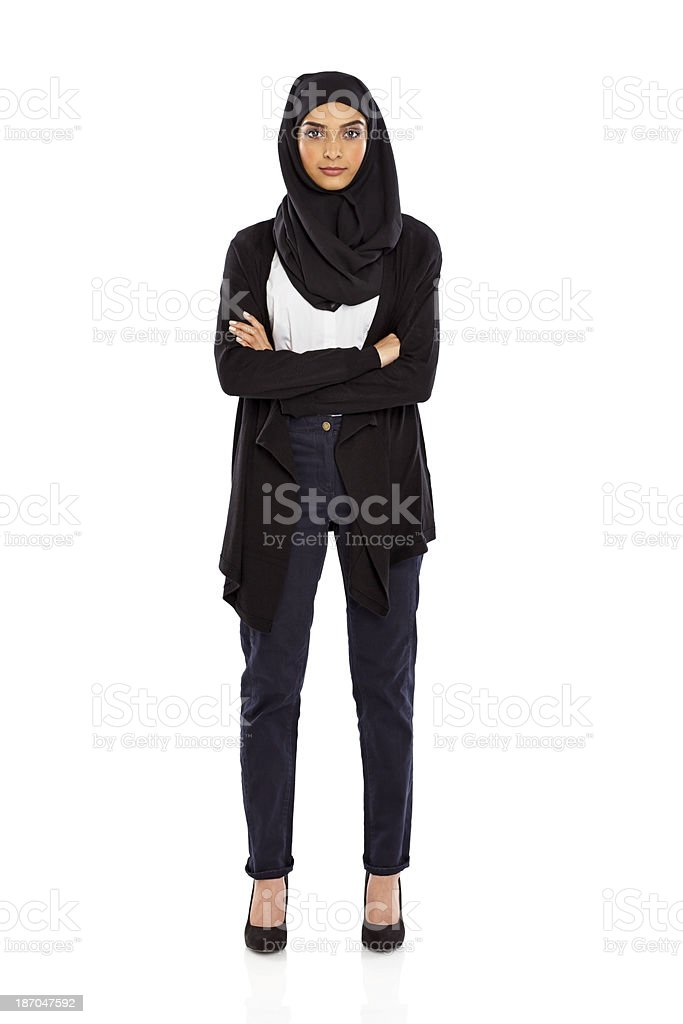 Confident young muslim woman standing on white stock photo