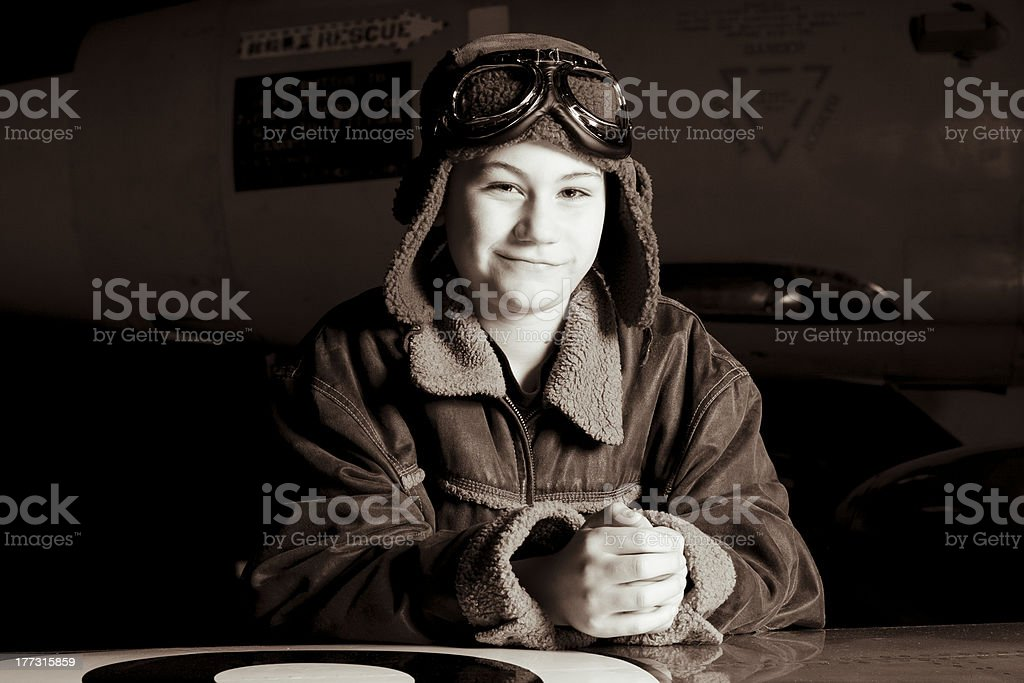 Confident young pilot gazing at the camera royalty-free stock photo
