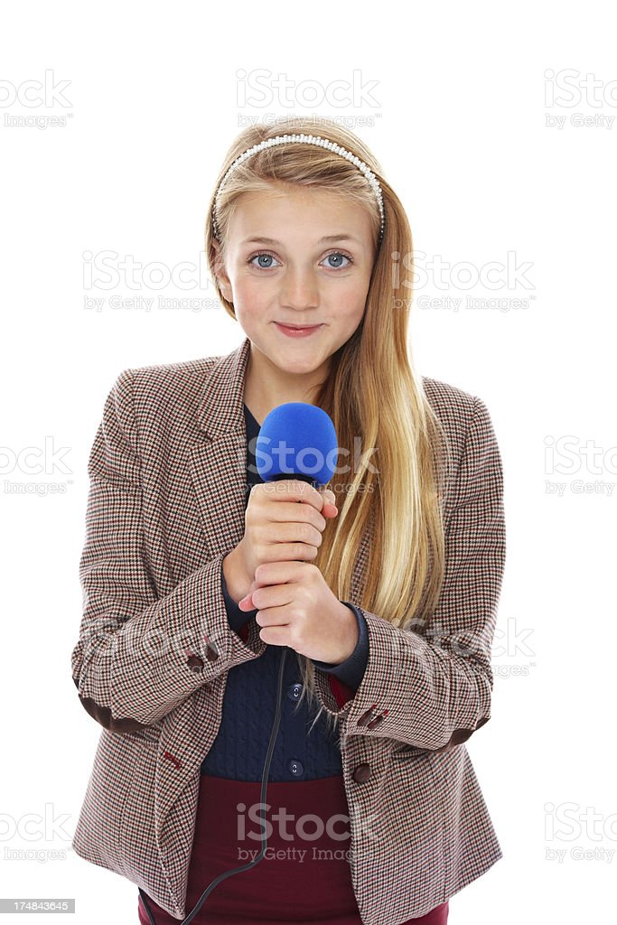 Confident young reporter holding microphone stock photo