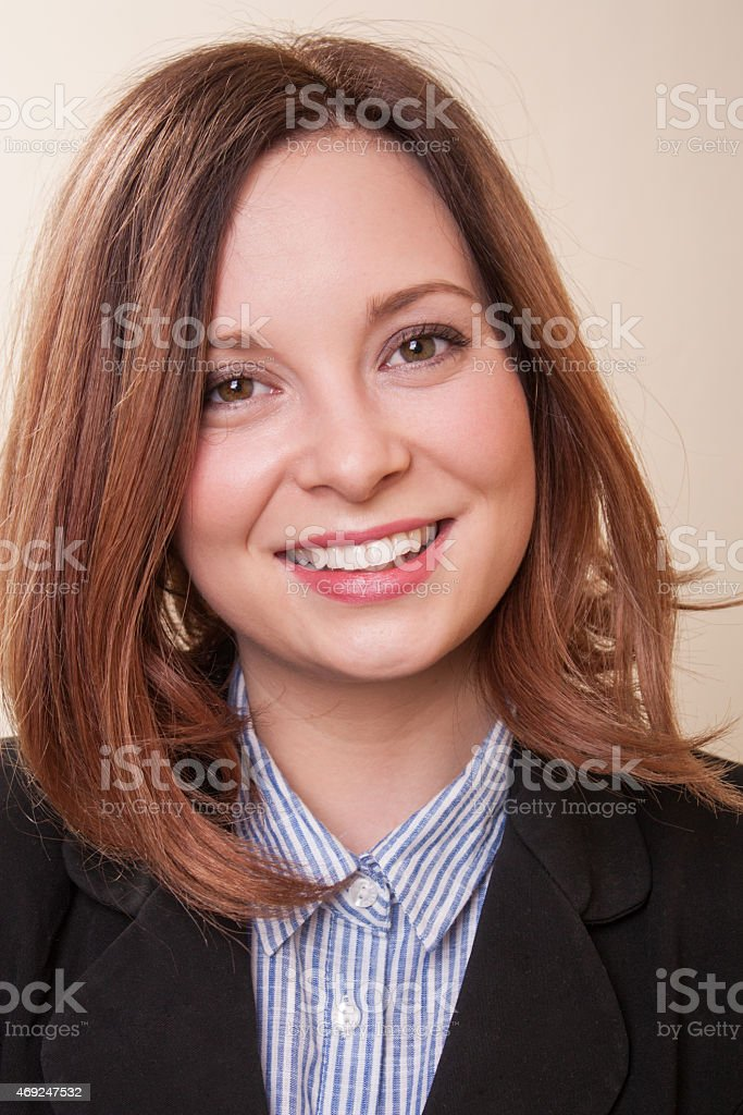 Confident young smiling businesswoman stock photo