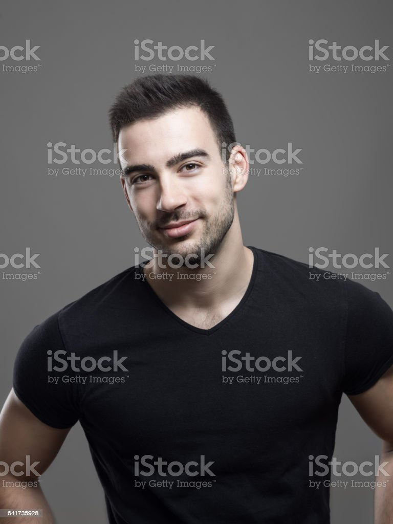 Confident young smiling fitness male model in blank black shirt stock photo