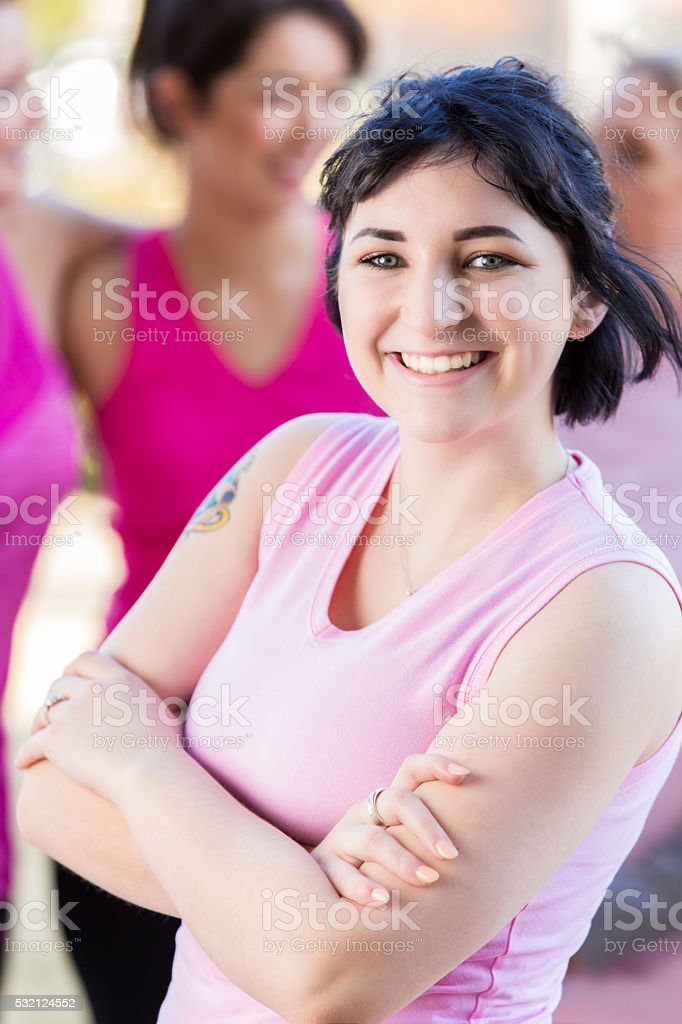 Confident young woman at charity race stock photo