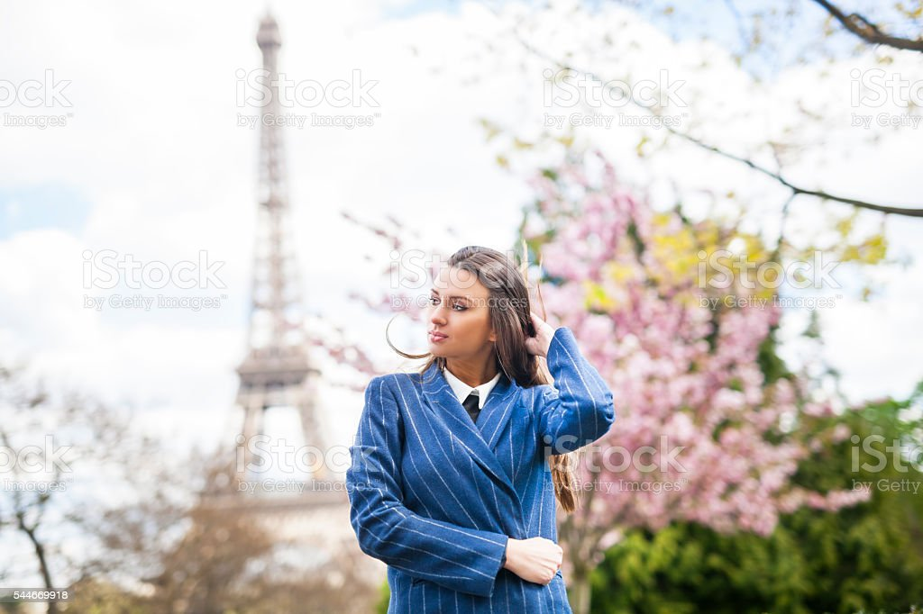 Confident Young Woman At The Eiffel Tower stock photo